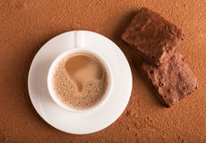 Cup of cappuccino and chocolate brownies Royalty Free Stock Photo