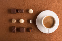 Cup of cappuccino and chocolate candies Royalty Free Stock Image