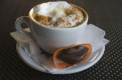 Cup of cappuccino with chocolate lips Stock Photos