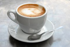 A cup of cappuccino close up royalty free stock photo