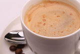 Cup of cappuccino and coffee beans Royalty Free Stock Image