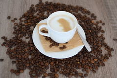 Cup of cappuccino and coffee beans Stock Photos