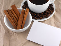 Cup of cappuccino or coffee with cinnamon and coffee beans Royalty Free Stock Photos