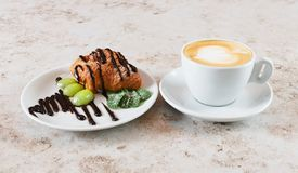 Cup of cappuccino coffee and the croissant Royalty Free Stock Photography