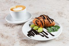 Cup of cappuccino coffee and the croissant Stock Photo