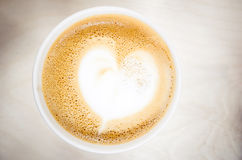 Cup of cappuccino coffee with heart shaped milk foam Royalty Free Stock Photo