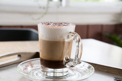 Cup of cappuccino coffee, hot mocha drink with cinnamon and coco Stock Image
