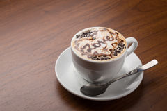 Cup of cappuccino coffee. Isolated on wooden background Royalty Free Stock Photo