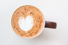 Cup of cappuccino coffee with the milky foam on top Stock Image