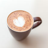 Cup of cappuccino coffee with the milky foam on top Stock Photo