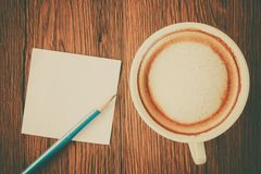 Paper note with pencil and coffee cup Royalty Free Stock Photo