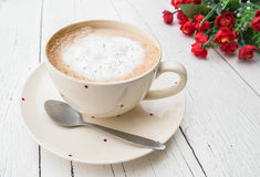 Cup of cappuccino coffee and rose Stock Images