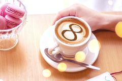 Coffee cup concept infinity symbol. A cup of cappuccino coffee with a symbol of the symbol of infinity on milk foam royalty free stock photo