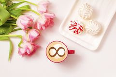 Coffee cup concept infinity symbol. A cup of cappuccino coffee with a symbol of the symbol of infinity on milk foam stock photo