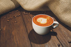Cup of cappuccino coffee at wood Stock Image