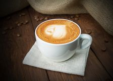 Cup of cappuccino coffee at wood Stock Photography