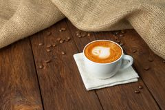 Cup of cappuccino coffee at wood Stock Images
