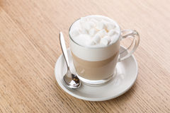 Cup of cappuccino coffee on wooden background. Cup of cappuccino coffee with marshmallow on wooden background Stock Image