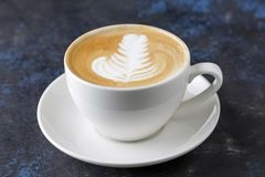 Cup of cappuccino on a colorful background. Cup of cappuccino with pattern on the foam Royalty Free Stock Images