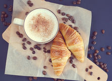 Cup of cappuccino and croissant royalty free stock photos