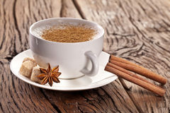 Cup of cappuccino decorated with spices. Stock Photos