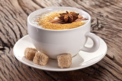 Cup of cappuccino decorated with spices. Royalty Free Stock Image