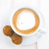 Cup of cappuccino and flavored cookies, closeup, top view Stock Image