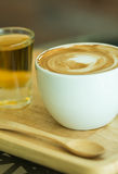 Cup of cappuccino with foam Stock Images