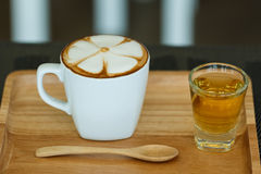 Cup of cappuccino with foam and tea Royalty Free Stock Photo