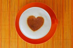 Cup of cappuccino. Cappuccino with heart ornament made of cinnamon Stock Images