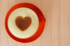 Cup of cappuccino. Cappuccino with heart ornament made of cinnamon Stock Image
