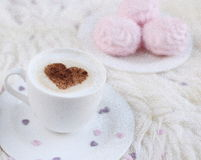 Cup with cappuccino. And heart pattern of cinnamon Royalty Free Stock Image