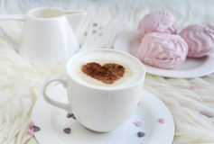 Cup with cappuccino. And heart pattern of cinnamon Stock Photography