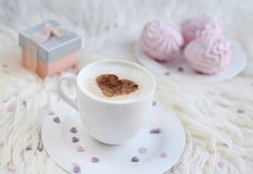Cup with cappuccino. And heart pattern of cinnamon Stock Images