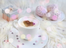 Cup with cappuccino. And heart pattern of cinnamon Stock Photo