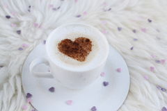 Cup with cappuccino. And heart pattern of cinnamon Stock Image