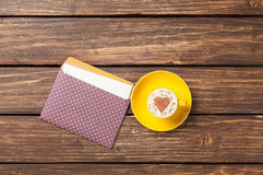 Cup of cappuccino with heart shape and envelope Royalty Free Stock Photos