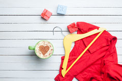 Cup of cappuccino with heart shape and gifts with hanger Stock Image