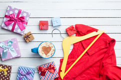 Cup of cappuccino with heart shape and gifts with hanger Royalty Free Stock Photography