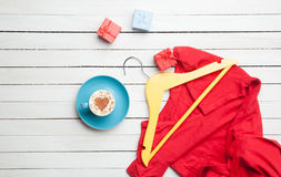 Cup of cappuccino with heart shape and gifts with hanger Royalty Free Stock Photo