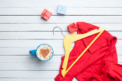 Cup of cappuccino with heart shape and gifts with hanger Royalty Free Stock Photos