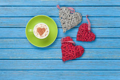 Cup of Cappuccino with heart shape symbol and toys Stock Photos