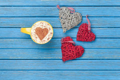 Cup of Cappuccino with heart shape symbol and toys Royalty Free Stock Photo