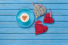 Cup of Cappuccino with heart shape symbol and toys Royalty Free Stock Photography