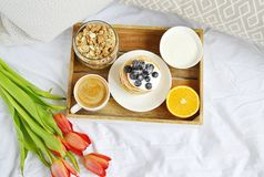 Cup with Cappuccino and Homemade Pancakes Sour Cream Berries Granola Orange Healthy Breakfast. Morning Concept Woman`s Day Flowers Tulips Daffodils Stock Images