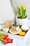 Cup with Cappuccino and Homemade Pancakes Sour Cream Berries Granola Orange Healthy Breakfast. Morning Concept Woman`s Day Flowers Tulips Daffodils Stock Photos