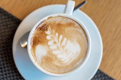 Cup of cappuccino with latte art. Beautiful foam, white cups.  royalty free stock photo