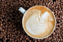 A cup of cappuccino or latte with foam with a Royalty Free Stock Image