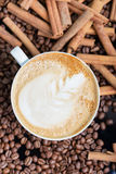A cup of cappuccino or latte with foam with a Stock Image