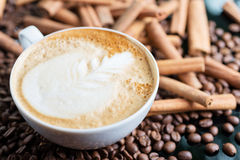 A cup of cappuccino or latte with foam with a Royalty Free Stock Photo